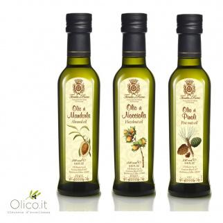 Trio von Ölen: Mandelöl, Pinienkernöl, Haselnussöl